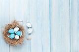 Fototapety Easter background with eggs in nest