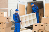 Fototapety Movers Unloading Furniture From Truck