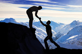 Man Assisting Male Friend In Climbing Rock - Fine Art prints