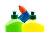 three colored bottles of detergent on white
