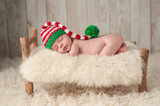 Newborn Baby Boy Wearing a Christmas Elf Hat