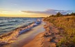 Beach Background. Beautiful sandy beach stretches to the blue sky horizon.