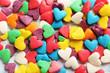 Obrazy na płótnie, fototapety, zdjęcia, fotoobrazy drukowane : Colorful candy hearts on a blue wooden table