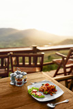 Food. Dinner In Thai Restaurant Outdoors. Healthy Noodles with sea food. Meal On Wooden Table. Beautiful Landscape, View, Hills On Background. Travel To Luxury Tropical Resort.