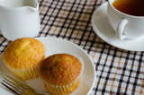 Butter Cup Cake and A Cup of Tea with Milk for Tea Break.