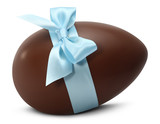 Fototapety Chocolate Easter Egg with blue ribbon Bow isolated on white back