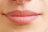 Close-up of closed female mouth - 100360781