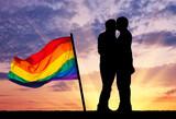 Silhouette happy gay kissing