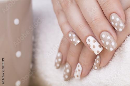 Beauty treatment photo of nice manicured woman fingernails. Very nice feminine nail art with nice nude and white nail polish. © tamara83
