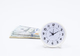Dollar banknote and clock