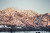 snow capped mountains with sun setting lighting them in ogden utah