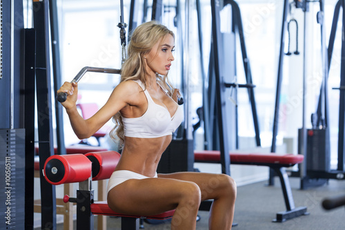 Woman working out on training machine