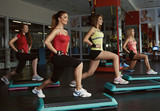 Fototapety Step course in the gym. Group of female doing aerobics fitness for losing weight.