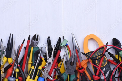 Poster Tools to use in electrical installations on wooden background