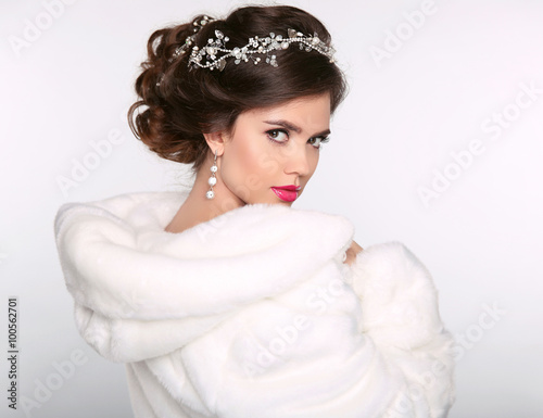 Winter beauty woman in white fur coat. Fashion model portrait. J