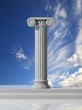 Ancient pillar with blue sky background.