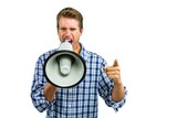 Portrait of angry man yelling through megaphone