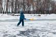 boy playing pond hockey.
