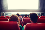 happy couple watching movie in theater or cinema - 100641916