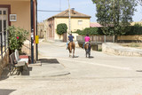people riding horses on a town street