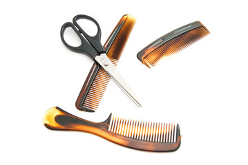 different brown combs and scissors
