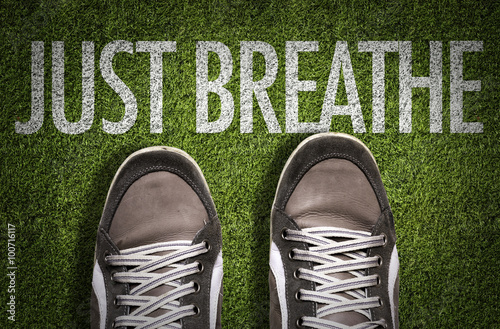 Poster Top View of Sneakers on the grass with the text: Just Breathe