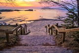 Fototapety Lake Superior Sunset. Stairs leading to a beautiful Lake Superior sunset beach at the Hurricane River Campground in Pictured Rocks National Lakeshore.