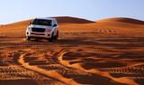 Off road vehicle on sand dunes, Oman