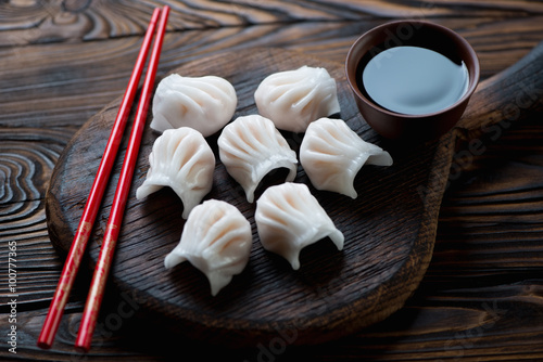 Plakát, Obraz Close-up of chinese dim-sum dumplings served with a soy sauce
