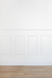 Empty white room with parquet floor and wood trimmed wall - 100794984