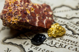 Close-up of ore deposits (gold, coal & bauxite) and an old map of Africa