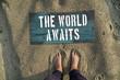 The world awaits. Motivational poster. Travel concept.