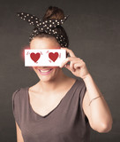 Pretty girl holding paper with red heart drawing