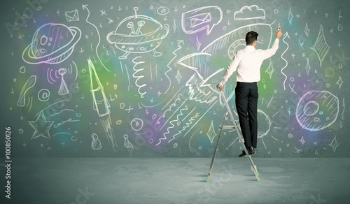 Foto op Canvas UFO Young businessman drawing rocket
