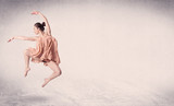 Fototapety Modern ballet dancer performing art jump with empty background