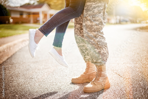 Young military couple kissing each other, homecoming concept, wa