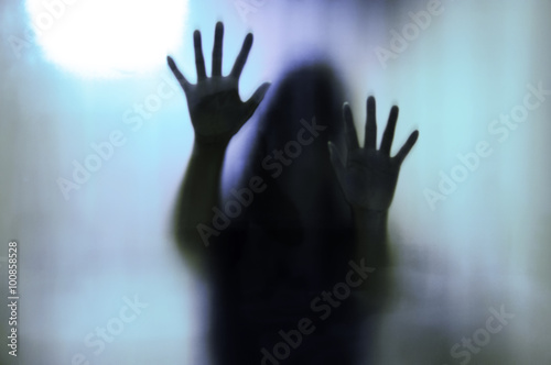 Woman behind the matte glass. Blurry hand and body figure Poster