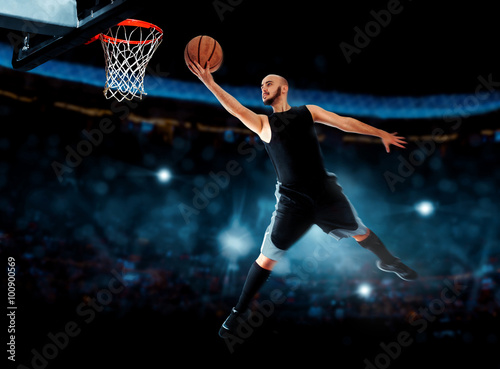 Poster Photo of basketball player makes layup in the game