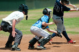 Fototapety High school baseball catcher with referee during game.