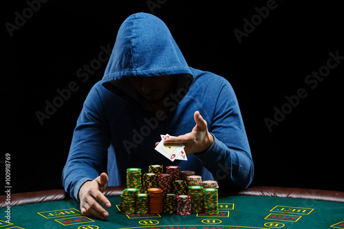Poker player showing a pair of aces плакат
