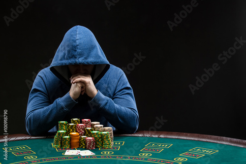 Poker player looking at combination of two aces. Closeup плакат