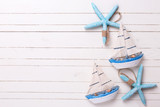 Decorative sailing boats and marine items on wooden background. - 100925174