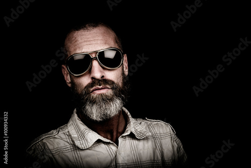 Portrait of a man with beard and sunglasses Poster