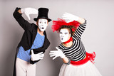 Fototapety Waist-up portrait of funny mime couple with white faces. April Fools' Day - concept