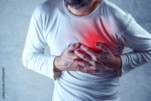 Zdjęcia na płótnie, fototapety, obrazy : Severe heartache, man suffering from chest pain, having painful