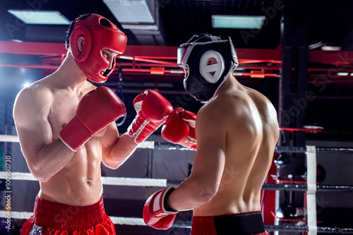 Fototapeta Skillful two opponents are sparing with each other