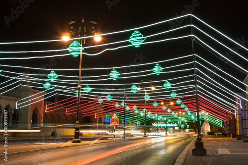 Street in Muscat decorated with lights. Oman, Middle East Poster