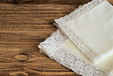 Handkerchiefs.  Handkerchiefs with a decorative trim on a brown wooden background.
