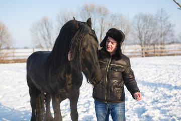 Man with frisian horse