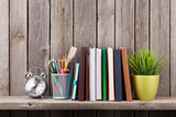 Fototapety Wooden shelf with books and supplies